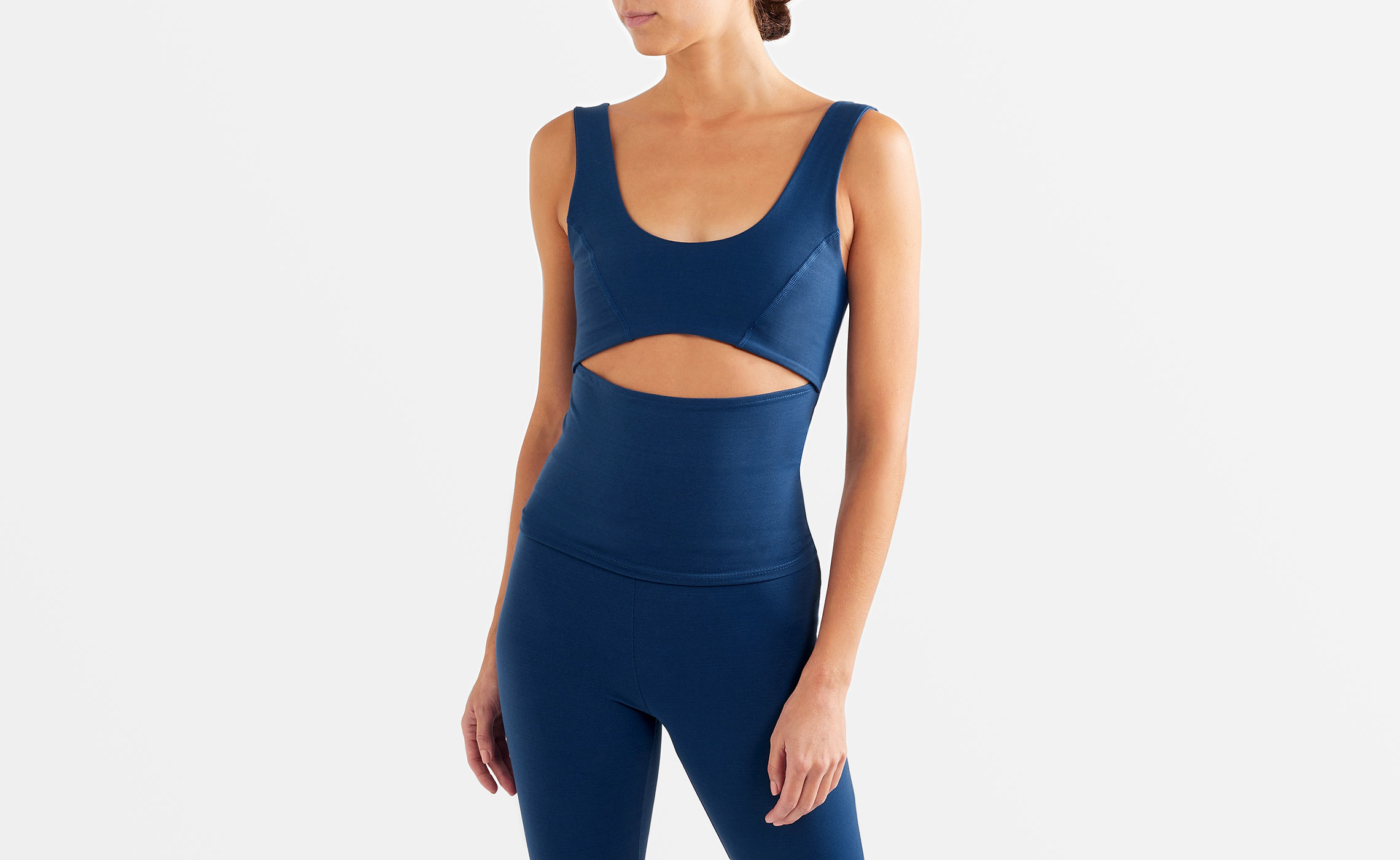 Woman wearing a Live the Process navy blue activewear set