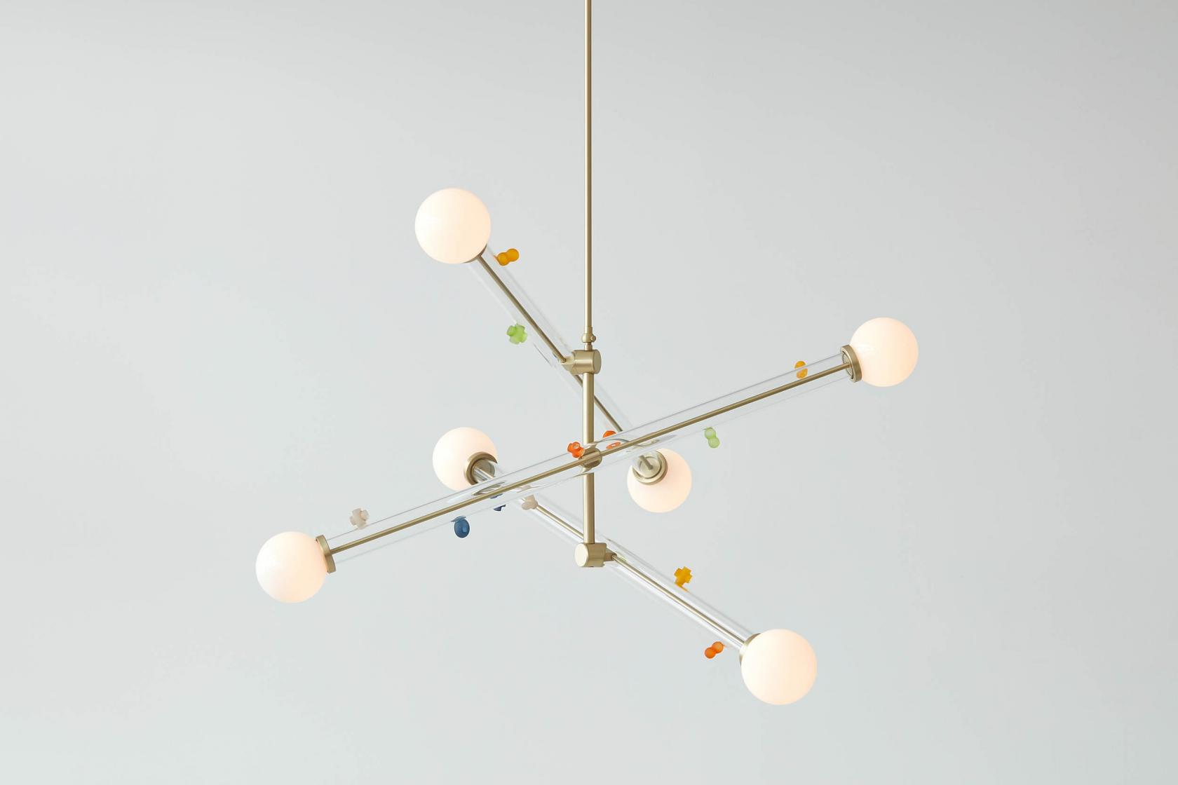 The 'Little World' chandelier with its soft, otherworldly forms.
