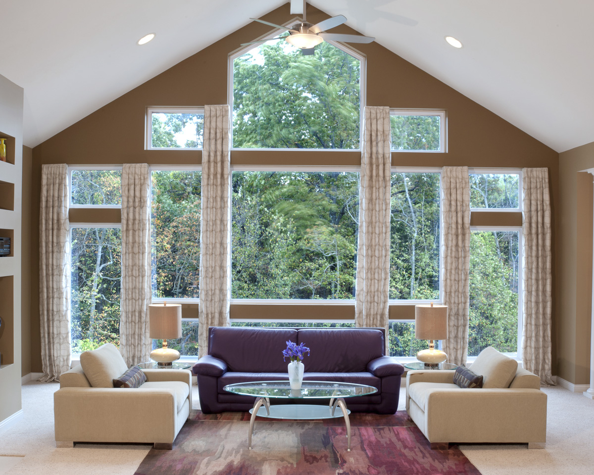 A beautiful living room interior with tall windows