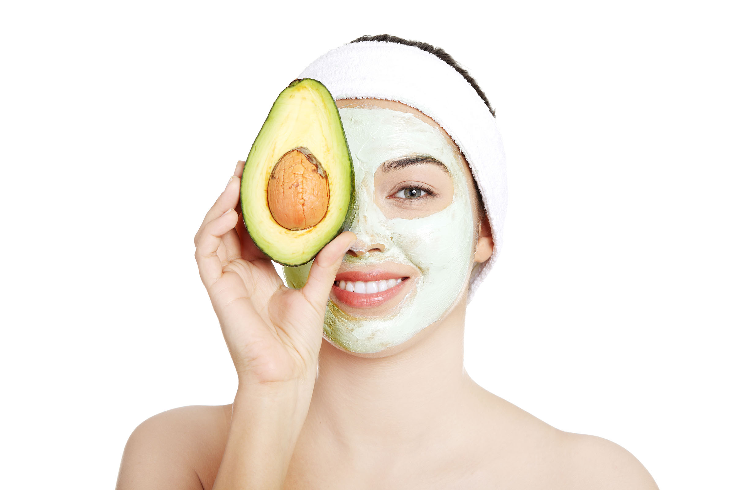 Young woman with an avocado-based face mask on her face