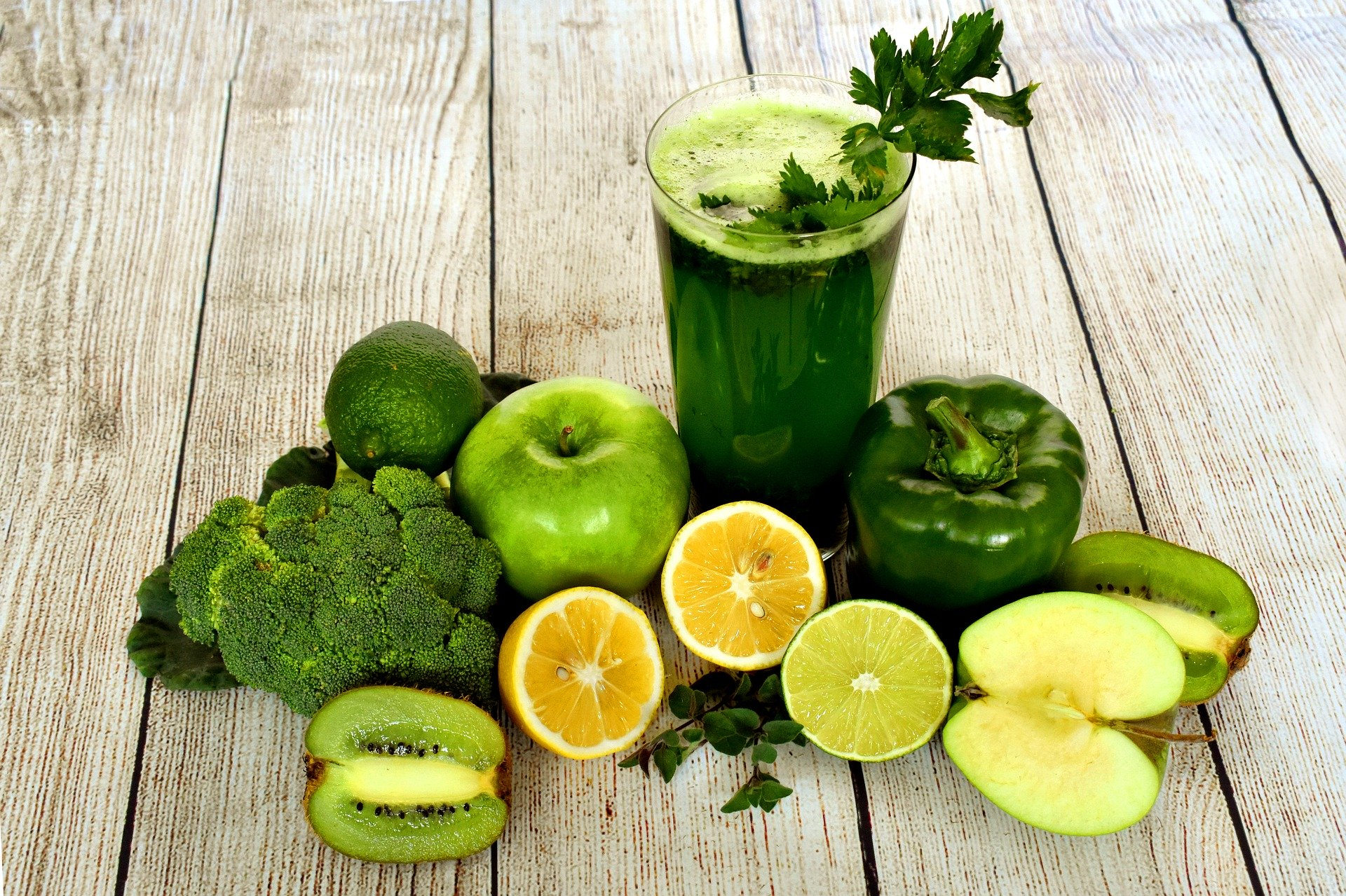 Green juice with a bunch of green veggies and fruits