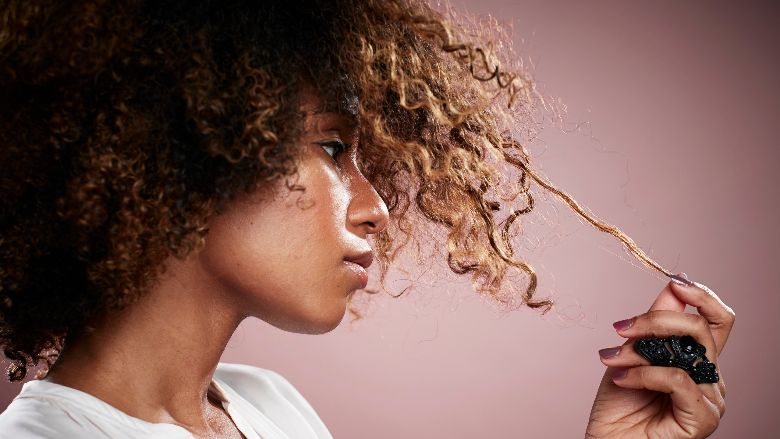 Woman holding a strand of her hair