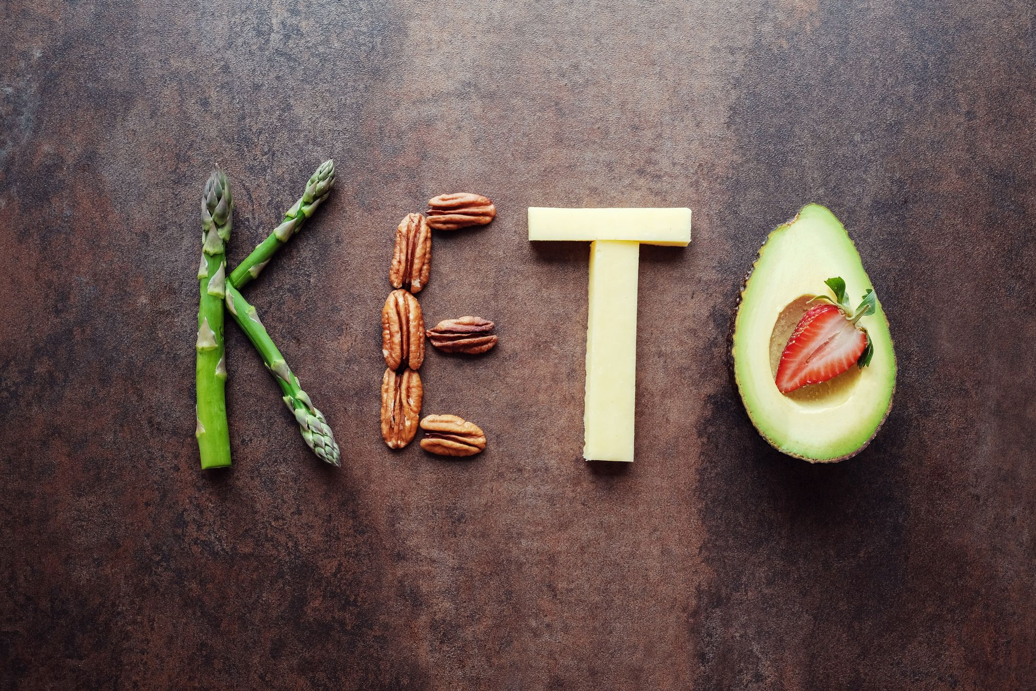 """An arrangement of the word """"Keto"""" with keto-friendly foods"""