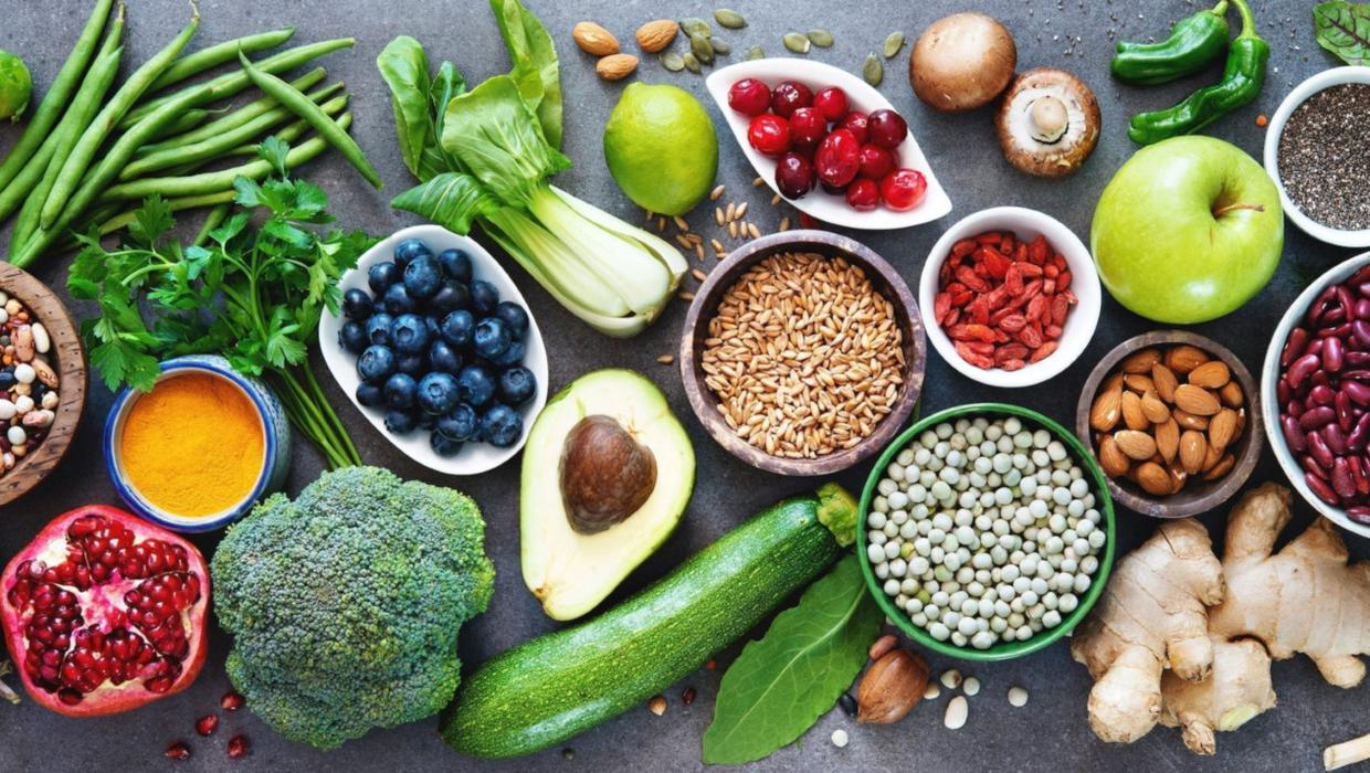 An arrangement of fruits, veggies, and nuts that are keto-friendly