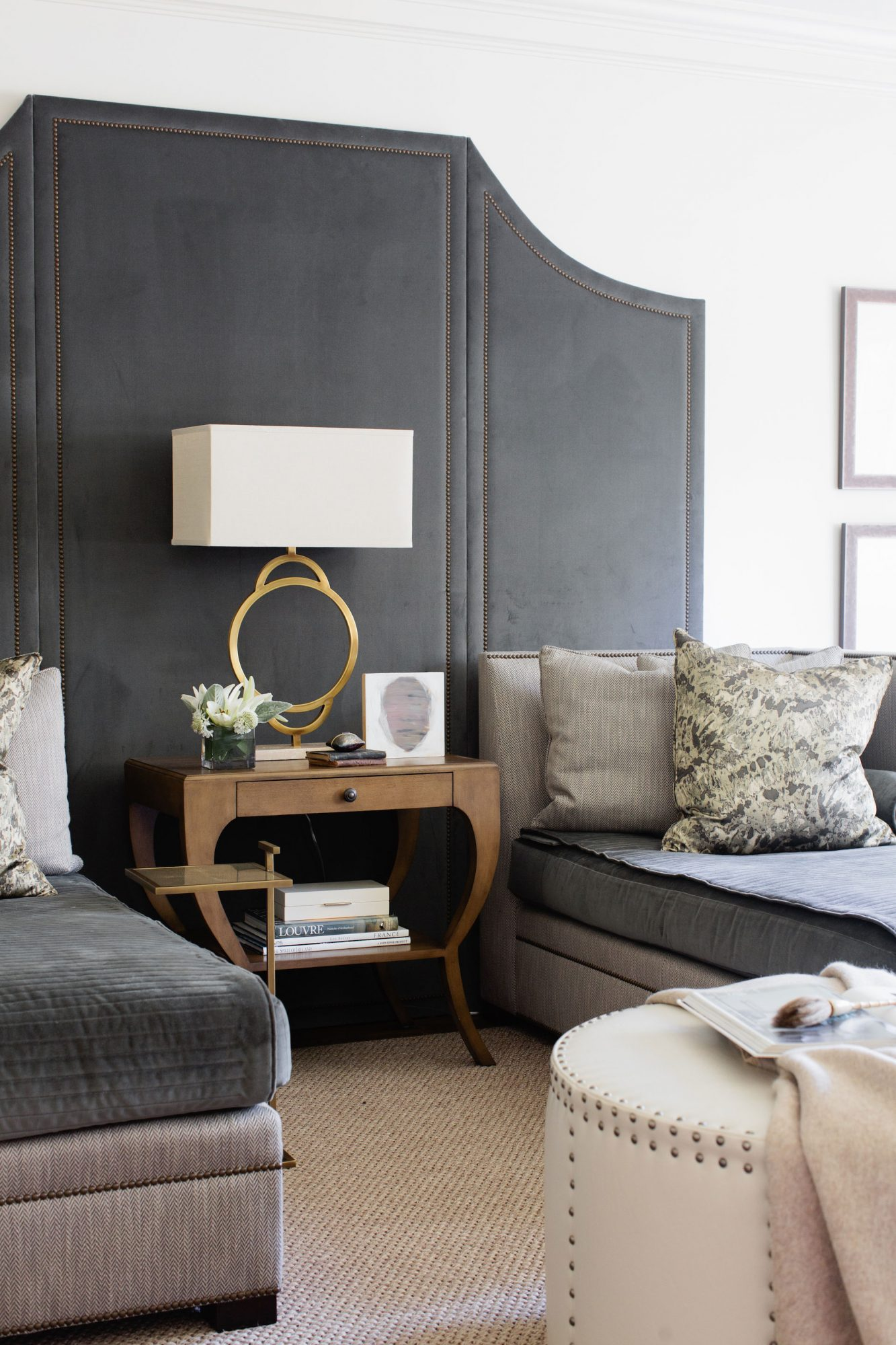 An interior with repeat fabrics in different shades of grey