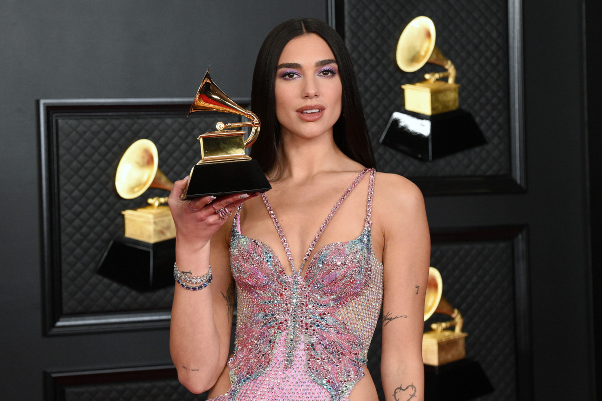 singer Dua Lipa wearing a butterfly Versace dress at the 2021 Grammys afterparty